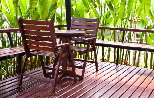 9551806-Wooden-chairs-and-table-in-coffee-shop-Stock-Photo-furniture-wooden-terrace